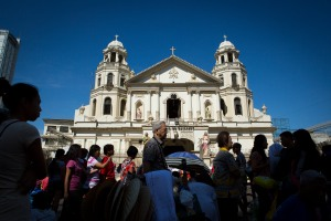 People stroll in front of the Minor Basilica of the Black Nazarene in Quiapo Feb. 2. Many Filipinos believe the sacred statue of Jesus Christ has miraculous powers. (CNS photo/Tyler Orsburn)