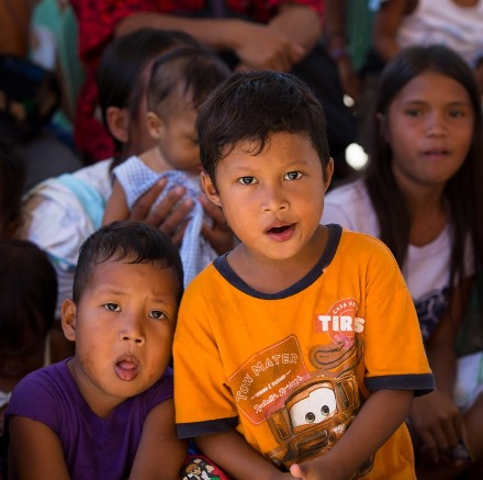 Children in Tanauan, Philippines, have been counseled by volunteers to help them overcome fears stemming from November's typhoon. (CNS/Tyler Orsburn)