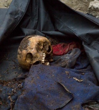 The remains of John Steve Cobacha, 16, were discovered Feb. 7, nearly three months after Typhoon Haiyan hit Tanauan, Philippines. (CNS/Tyler Orsburn)