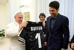 Pope Francis receives a jersey from Juventus' soccer goalkeeper and coach during a private audience at Vatican