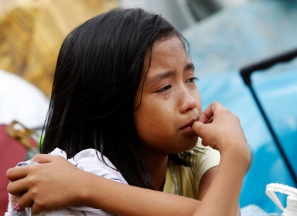 Girl cries as she watches workers government demolition crew dismantle shanties in Philippines