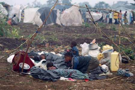 Congolese family displaced by violence rests in open at camp in Uganda