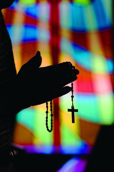 MAN PRAYS ROSARY AT OKLAHOMA CHURCH