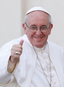 Pope Francis gives thumbs as he leaves St. Peter's Square after celebrating Palm Sunday Mass