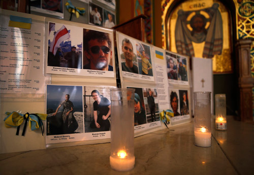 Pictures of victims of the recent protest violence in Kiev, Ukraine, are displayed near the altar during a morning prayer service at the St. George Ukrainian Catholic Church in New York City March 4. (CNS/Reuters)