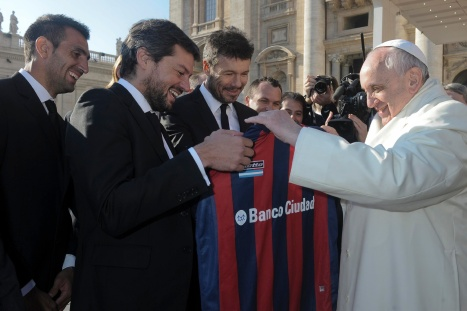 Pope Francis holds a jersey of Argentine soccer team San Lorenzo during his general audience in St. Peter's Square at the Vatican Dec. 18. (CNS/L'Osservatore Romano via Reuters)