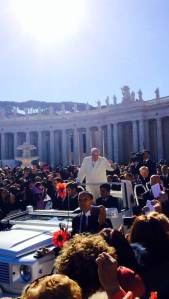 Pope Francis greets the  cheering crowd as he rides around St. Peter's Square in the popemobile before his general audience this morning. (CNS/Emily Antenucci)