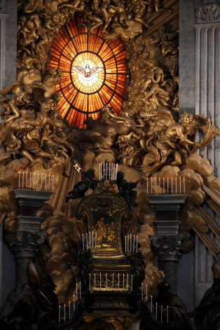 CANDLES ADORN SCULPTURE NEAR HOLY SPIRIT WINDOW IN ST. PETER'S BASILICA