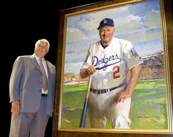 Tommy Lasorda stands next to his portrait  at the National Portrait Gallery in Washington in 2009. (CNS photo by Reuters)
