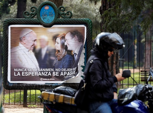A 2013 poster for midterm elections in Buenos Aires, Argentina, features a photo of Pope Francis with Argentina's President Cristina Fernandez de Kirchner and Martin Insaurralde, mayor of Buenos Aires' Lomas de Zamora district. (CNS photo/Reuters)