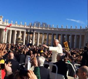 Pope Francis waves the crowd this morning. (CNS/Emily Antenucci)