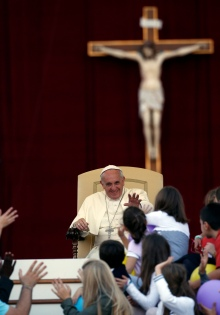 Pope Francis reacts to children during special event for families in St. Peter's Square