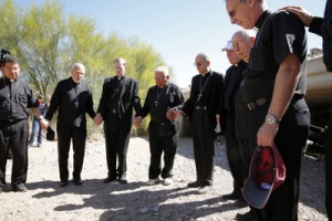 A group of U.S. bishops pray for immigrants at the end of their hike through part of the Sonoran Desert. (CNS photo/Nancy Wiechec)