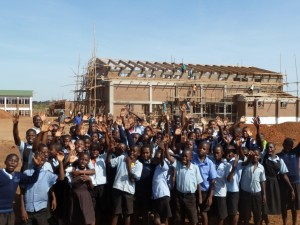 Students from St. Joseph Primary School in Kasungu, Malawi  cheer for the construction of Loyola Jesuit Secondary School, during a recent visit. (CNS/Courtesy Loyola Jesuit Secondary School)