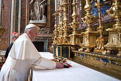 Newly-elected Pope Francis leaves flowers in front of icon at Rome basilica
