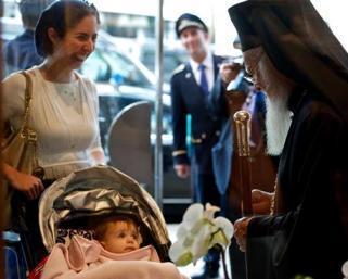 Ecumenical Patriarch Bartholomew of Constantinople stops to bless a baby as he leaves his hotel for his May 25 meeting with Pope Francis in Jerusalem. (CNS/Julie Holthaus/The Leaven)
