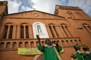 A member of a choir sings a song of reconciliation and peace in front of a Catholic cathedral during the last day of Easter celebrations in Bangui, Central African Republic, April 21. (CNS/Siegfried Modola, Reuters)