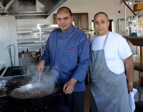 Chef Elias Akroush, 33, and pastry chef Peter Korfiatis, 48, prepare lunch for Pope Francis in the Casa Nova guesthouse in Bethlehem, West Bank, May 24. (CNS/Debbie Hill)