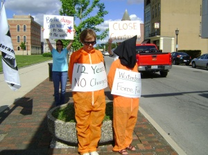 Josie Setzler and Franciscan Sister Paulette Schroeder, wearing hood, were among 17 members of the Tiffin, Ohio Area Pax Christi and the Sisters of St. Francis of Tiffin, calling for the closure of the U.S. prison at Guantanamo Bay, Cuba, May 23 in the Northwest Ohio town. (CNS/courtesy Tiffin Area Pax Christi)