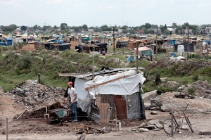 A man walks next to his makeshift home in 2008 in Buenos Aires, Argentina. The U.S. Supreme Court denied an appeal by Argentina in a case in which a hedge fund has sued the country for $1 billion, meaning the country will be forced to turn over information about financial assets in New York banks and face the possibility of not providing development aid for the country's poorest residents. (CNS/Cezaro De Luca, EPA)