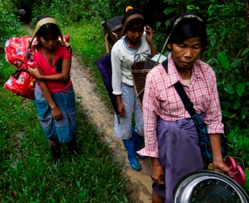 Women flee Nam Lim Pa village for the jungle in northern Myanmar in this 2011 handout photo released by the aid group Partners Relief and Development, which said government soldiers were committing serious human rights abuses, including rape, in a campaign against guerrillas. (CNS/Partners Relief and Development via Reuters)