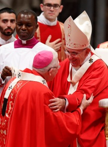 Archbishop Leonard P. Blair of Hartford, Conn., and Pope Francis -- wearing matching palliums --greeted each other yesterday. (CNS/Paul Haring)