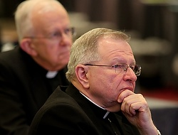 New Orleans Archbishop Gregory M. Aymond attends session on opening day of bishops' spring assembly. (CNS photo/Bob Roller)