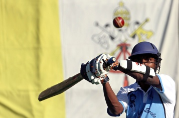 A player from a team of priests and seminarians returns a ball during a cricket training session in Rome Oct. 22, 2013. (CNS photo/Alessandro Bianchi, Reuters)