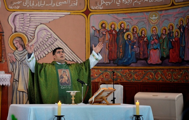 Father Jorge Hernandez, a member of the Institute of the Incarnate Word, celebrates Mass at the Gaza parish in 2011.  (CNS/Paul Jeffrey)