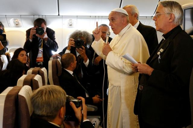 Pope Francis answers questions Aug. 18 during the flight from Seoul, South Korea, back to Rome. (CNS/Paul Haring)