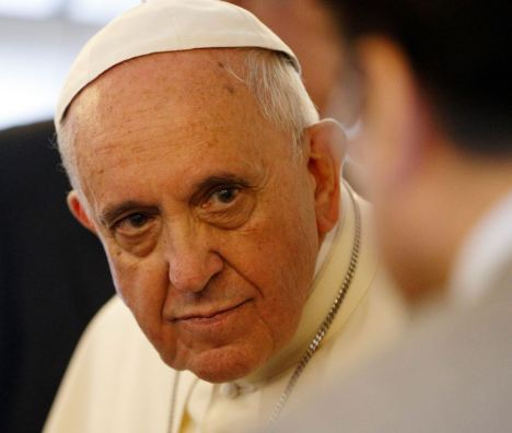 Pope Francis listens to a journalist's question on the flight back to Rome. (CNS/Paul Haring)