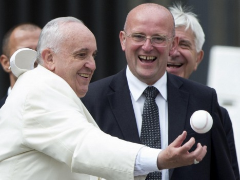 Pope Francis reaches out to grab a baseball thrown by someone in the crowd as he leaves his general audience in St. Peter's Square Sept. 24.  (CNS photo/Claudio Peri, EPA)
