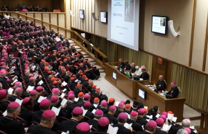 Participants in the 2012 Synod of Bishops in the Vatican synod hall with Pope Benedict XVI. (CNS/Paul Haring)