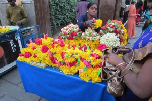 Worshipers buy flowers and candles to place at shrine of Mary in Bangalore, India.