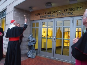 Cardinal Edwin F. O'Brien blesses newly named headquarters of U.S. military archdiocese in Washington. (CNS photo/Julie Asher)
