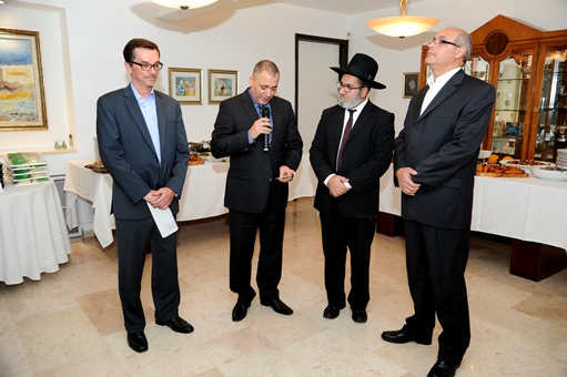 The U.S. Embassy in Tel Aviv sponsored an interfaith Thanksgiving meal at the  of William Grant, deputy chief of mission, left. Representatives of three religions said a prayer of thanksgiving and blessing over the food before some 80 guests sat down to eat. Next to Grant are Fadoul Mazzawi, a Christian minister; Rabbi Menachem Shem Tov; Sheik Ghassan Manasra. (CNS/David Azagury)