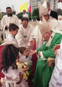 Pope John Paul II meets Cuban children during his 1998 visit. (CNS/REUTERS)