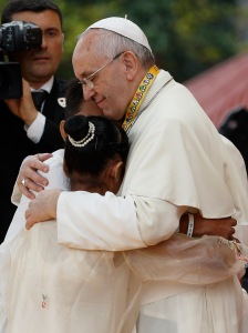 Pope Francis hugs Glyzelle Palomar and Jun Chura. (CNS/Paul Haring)