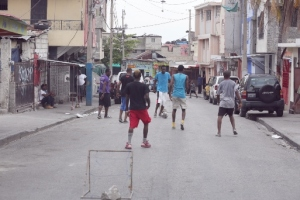 Boys play soccer in a traffic-free street in Port-au-Prince, Haiti, as the capital experienced a general strike aimed at lowering gas prices and urging elections. (CNS/Bob Roller)