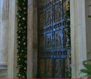 The Holy Door at St. Peter's Basilica decorated this evening. (Screen grab)
