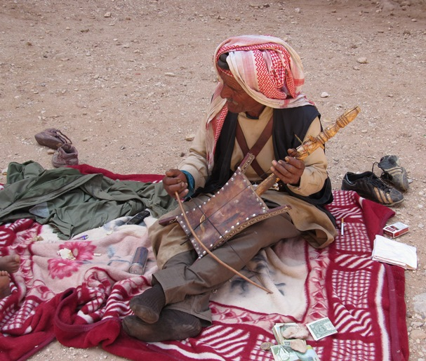 A man playing the one-stringed rababa for tips in Petra. (CNS/Mark Pattison)