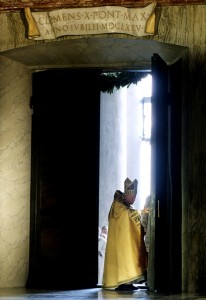 St. John Paul II pushes open the Holy Door on Dec. 24, 1999. (CNS/Arturo Mari, Vatican)