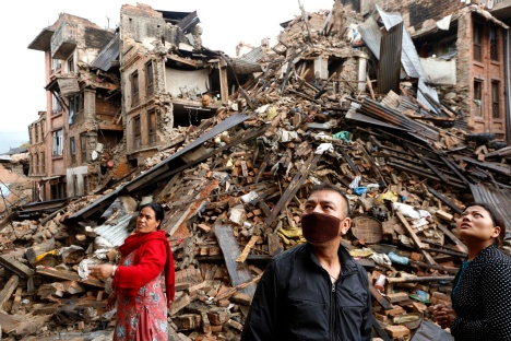 Survivors look at destroyed buildings April 27 following an earthquake in Bhaktapur, Nepal. More than 3,600 people were known to have been killed and more than 6,500 others injured after a magnitude-7.8 earthquake hit a mountainous region near Kathmandu April 25. (CNS photo/Abir Abdullah, EPA)