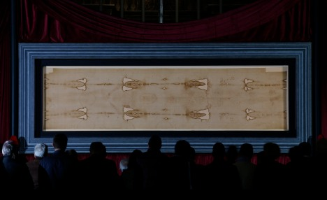 The Shroud of Turin unveiled yesterday for the media. Now on public display, (CNS/Paul Haring)