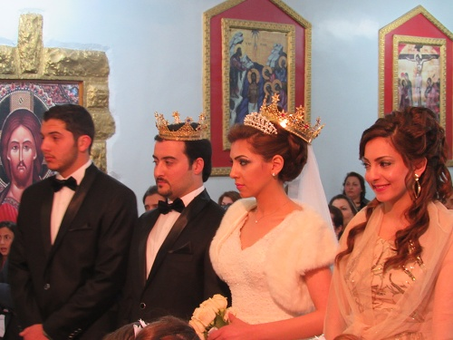 The bride and groom wear crowns at a Melkite Catholic wedding in Jordan. (CNS/Mark Pattison)