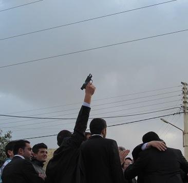 A pre-wedding ritual: firing a gun before the ceremony. (CNS/Mark Pattison)