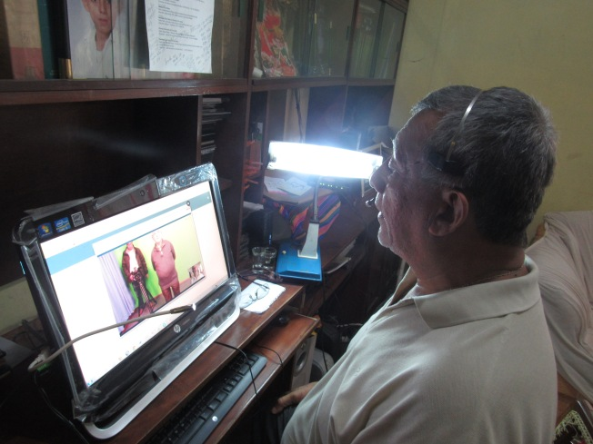 Father Estefan Turcios, a Salvadoran priest, is interviewed about Archbishop Oscar Romero via Skype by a TV station in Quito, Ecuador. (CNS photo by Rhina Guidos)