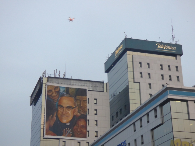 A drone flies over a large poster of Archbishop Oscar Romero near the square of the Monument of the Divine Savior in San Salvador, where he will be beatified pm Saturday (CNS photo by Rhina Guidos)