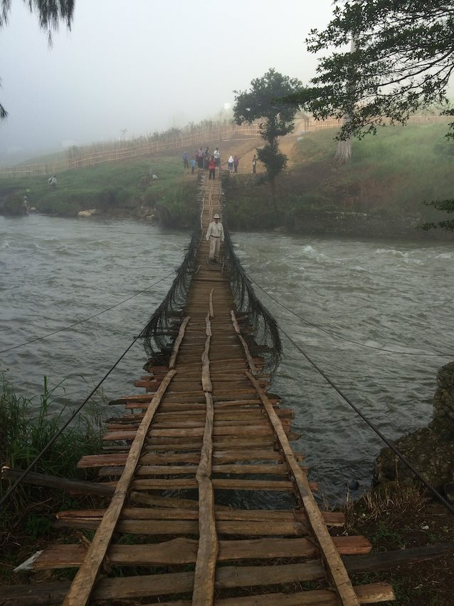 Bishop Donald Lippert on a foot bridge heading to a confirmation ceremony in his diocese in Papua New Guinea. (Courtesy of Bishop Donald Lippert)