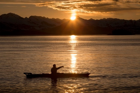 Father Thomas Weise kayaks off the shoreline of the Shrine of St. Therese in Juneau, Alaska. The photo won first place in the scenic category at the Catholic Press Association Awards.  (CNS photo/Nancy Wiechec)